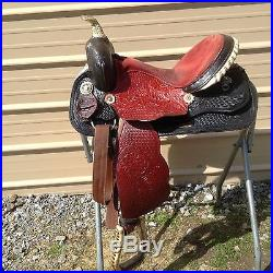 Used 15 black / red leather Western barrel race saddle good condition